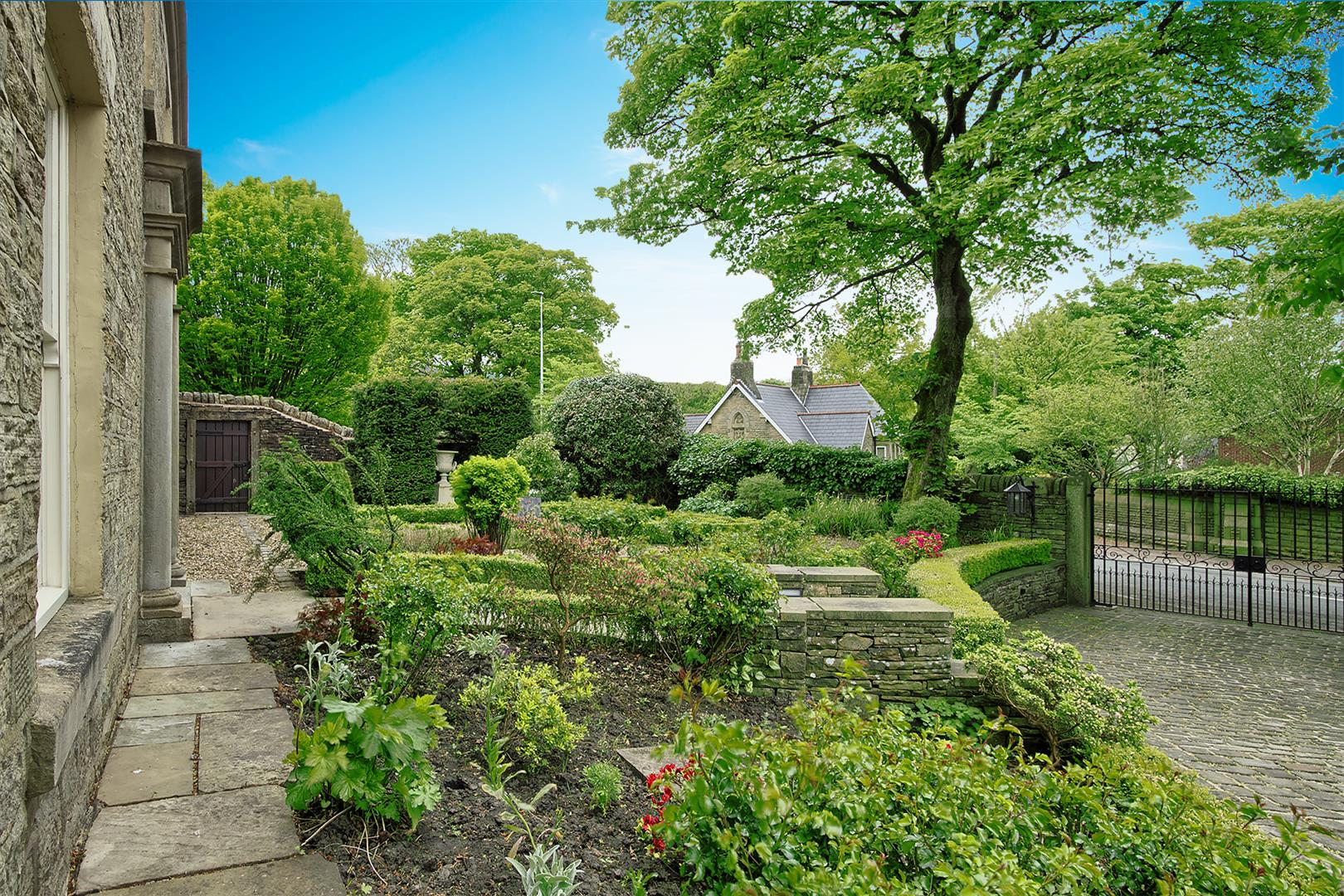 5 bedroom detached house For Sale in Bolton - front garden.png.